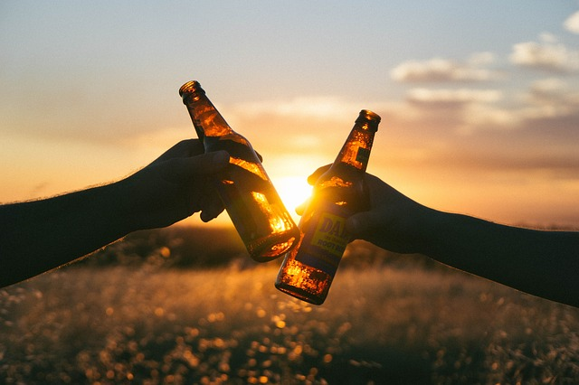 Dont compare you life to others, instead be happy for others success. A picture of two people clincking beers together