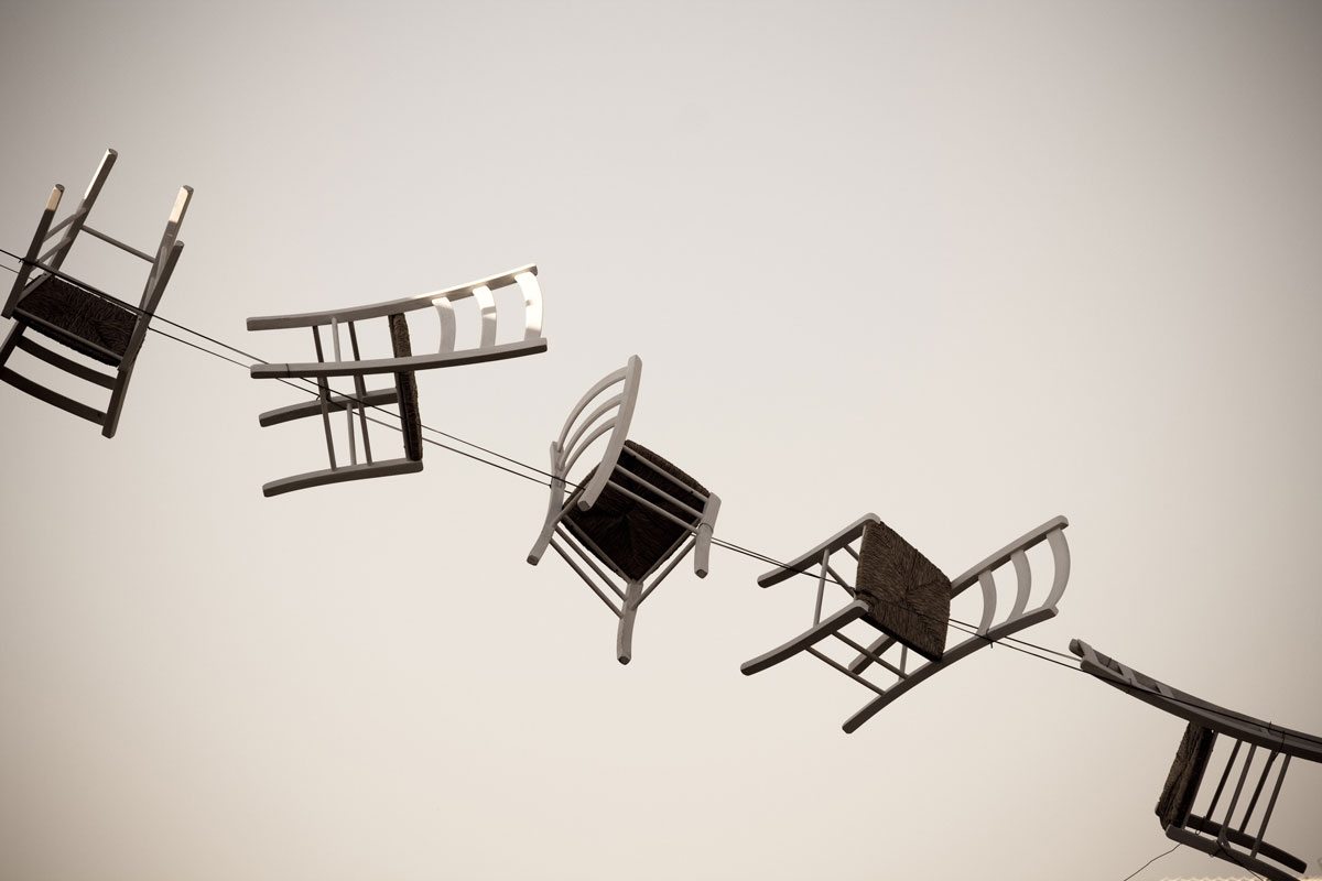 can art sculpture help with depression? An image of several chairs positioned artistically.