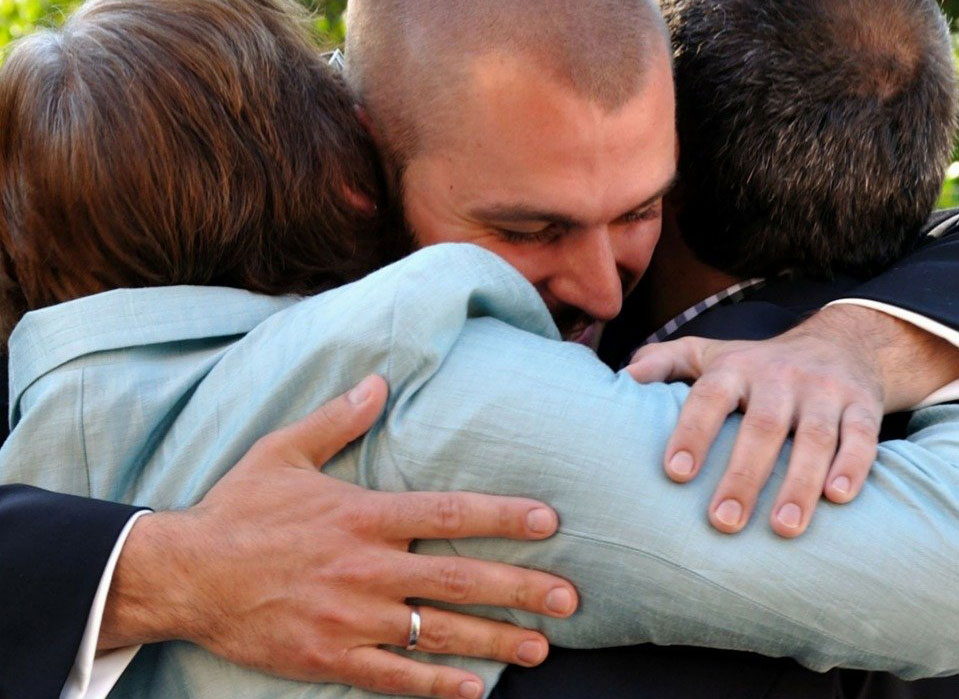 should i forgive someone who has wronged me? A man hugs to show forgiveness
