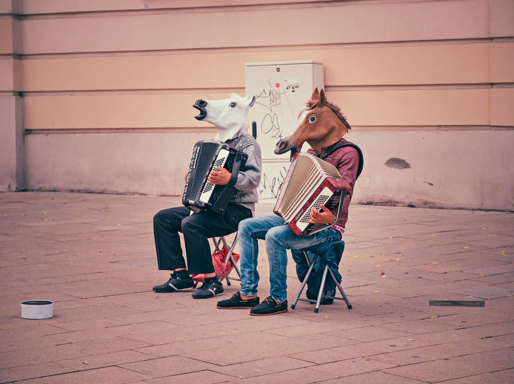 can laughter help overcome depression. Taking a lighter view can help. 2 men playing music with horse masks on
