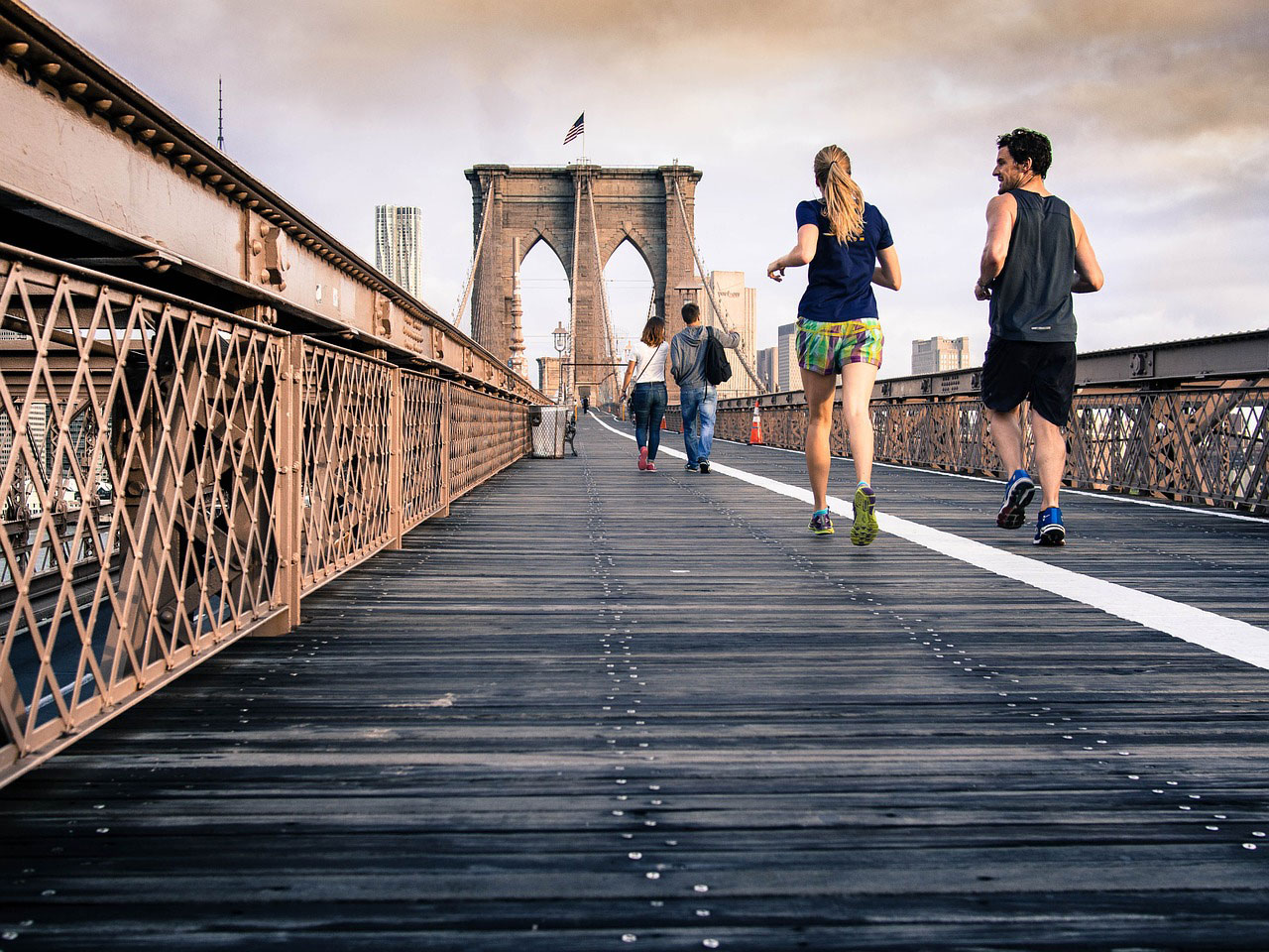 exercise is good for depression, picture of people running on a bridge