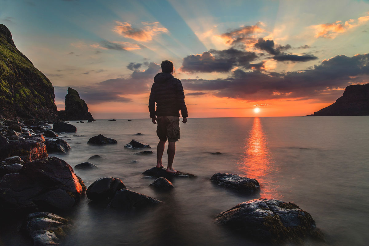 Natural cures for anxiety is CBT. The picture is a man looking at a sunset