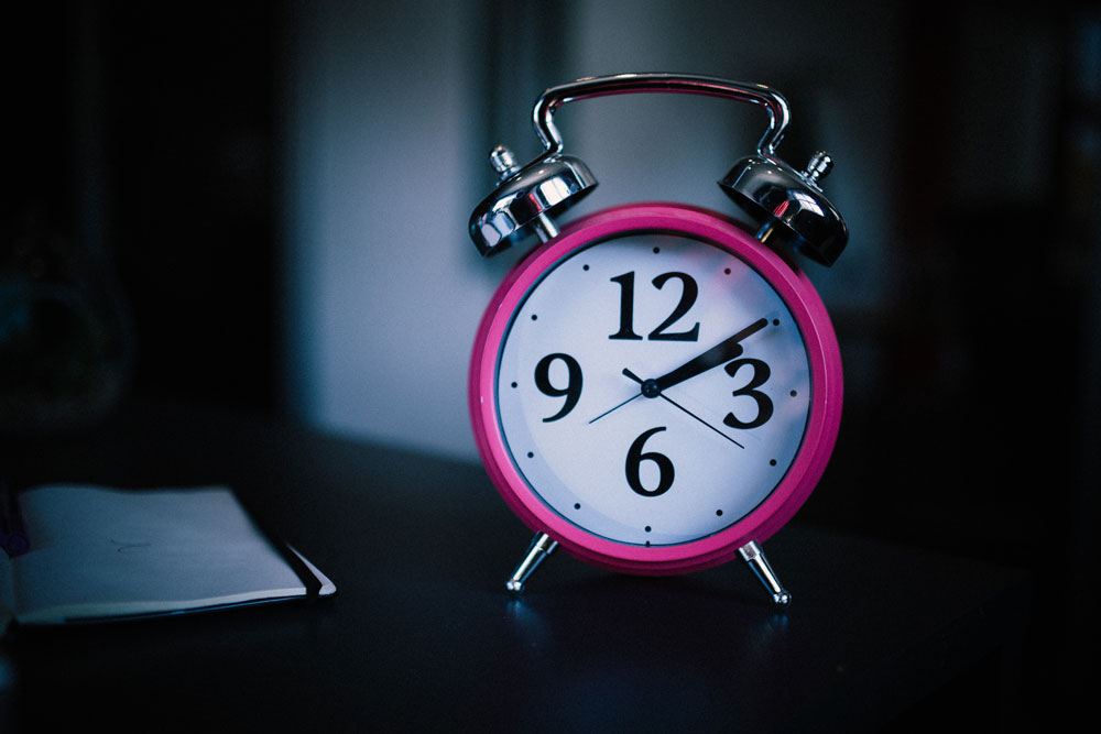 Getting good sleep is one of the natural cures for anxiety. A picture of an alarm clock