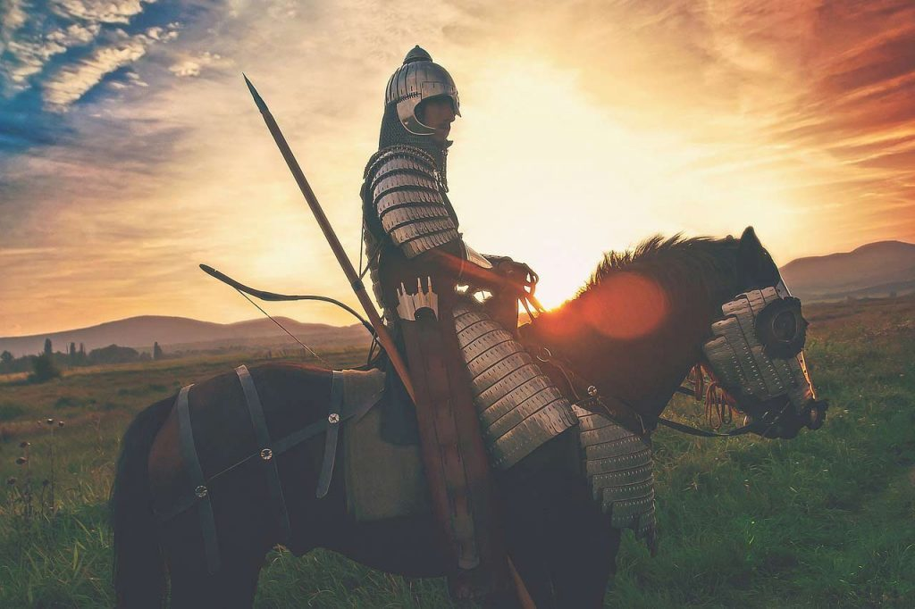 film about depression - the peaceful warrior. Shows a picture of a knight on a horse with a sunset behind