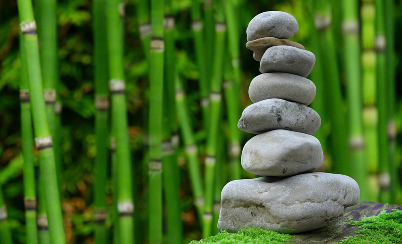 Start meditating. A picture of stones piled up
