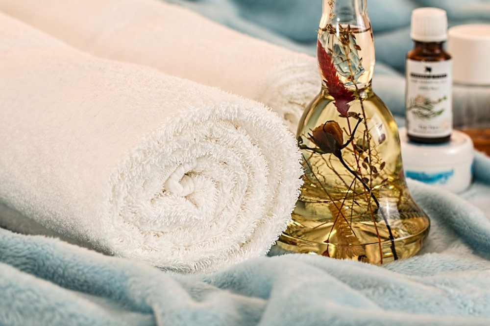 Find a local therapist by finding the right therapy for you. A picture of towels and some oils, probably representing massage therapy