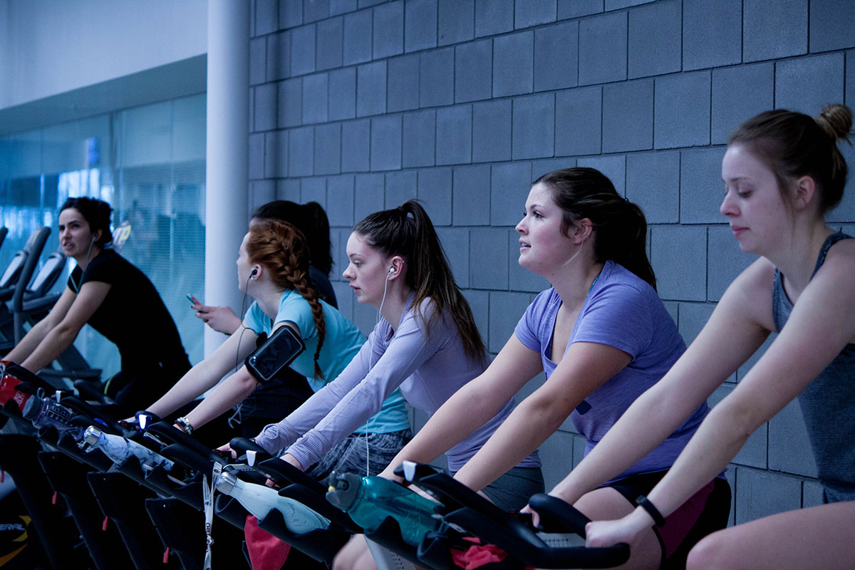 Going The Gym When You Suffer With Anxiety - 4 girls together on bikes supporting each other